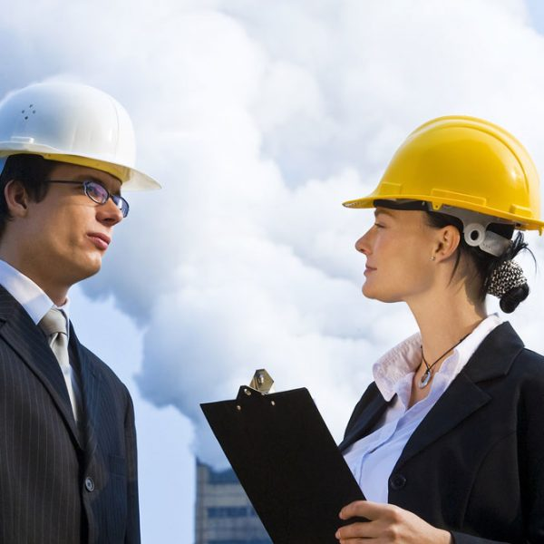 man and woman with hard hats